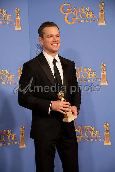 "After winning the category of BEST PERFORMANCE BY AN ACTOR IN A MOTION PICTURE – COMEDY OR MUSICAL for his work in ""The Martian,"" actor Matt Damon poses backstage in the press room with his Golden Globe Award at the 73rd Annual Golden Globe Awards at the Beverly Hilton in Beverly Hills, CA on Sunday, January 10, 2016. Photo Credit: HFPA/AdMedia"