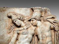 Close up of a Roman Sebasteion relief sculpture of Achilles and a dying Amazon, Aphrodisias Museum, Aphrodisias, Turkey.   <br /> <br /> Achilles supports the dying Amazon queen Penthesilea whom he has mortally wounded. Her double headed axe slips from her hands. The queen had come to fight against the Greeks in the Trojan war and Achilles fell in love with her.