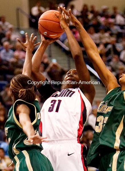 HARTFORD, CT. 04 March 2007-030407SV04--#31 Tina Charles of UConn goes up for a shot as #25 Jessica Dickson and #32 Nalini Miller of South Florida defend during Big East basketball tournament action at the Hartford Civic Center in Hartford Sunday.<br /> Steven Valenti Republican-American