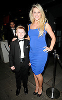 HARRY JOHNSON & AMY GUY.At the Active Harry new campaign launch party, Embassy nightclub, London, England, UK, .February 9th 2011..full length  sleeveless blue dress hand on hip black shoes ruched pregnant maternity bump bow tie tux tuxedo .CAP/CAN.©Can Nguyen/Capital Pictures.