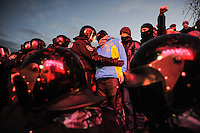"""Riot police  of the  special force """"Berkut"""" inspect a protester in the European square in Kiev. Ukraine Thousands of people are continuing to express their support to european integration and protesting against decision of Ukrainian government to refuse signing of association with EU in Vilnius."""