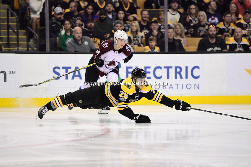 October 9, 2017: Boston Bruins defenseman Brandon Carlo (25) falls after blowing an edge during the NHL game between the Colorado Avalanche and the Boston Bruins held at TD Garden, in Boston, Mass. Colorado defeats Boston 4-0. Eric Canha/CSM