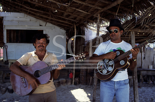 Palmares, Brazil. Two men playing guitars;  Pernambuco State, north-east Brazil.