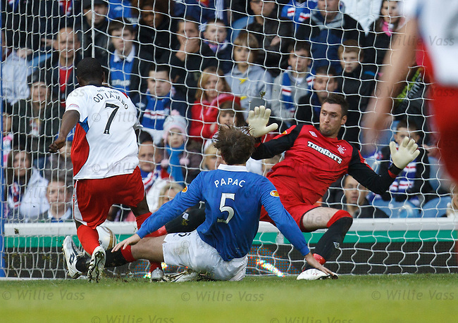 Eric Odhiambo scores for Inverness CT past Rangers keeper Allan McGregor as Sasa Papac challenges
