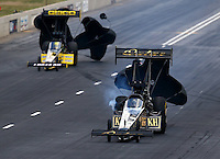 Jul. 19, 2014; Morrison, CO, USA; NHRA top fuel driver Khalid Albalooshi (right) alongside Richie Crampton during qualifying for the Mile High Nationals at Bandimere Speedway. Mandatory Credit: Mark J. Rebilas-
