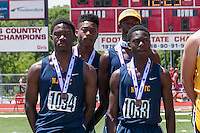 Cleveland NJROTC's fifth-place Class 2 4x200 relay team stands on the award podium at the Missouri Class 1 and 2 State Track and Field Championships in Jefferson City, Saturday, May 21.