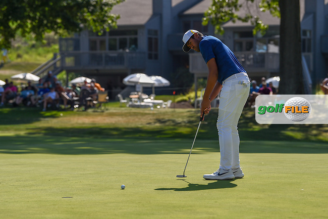 Tony Finau (USA) sinks his putt on 16 during 3rd round of the World Golf Championships - Bridgestone Invitational, at the Firestone Country Club, Akron, Ohio. 8/4/2018.<br /> Picture: Golffile   Ken Murray<br /> <br /> <br /> All photo usage must carry mandatory copyright credit (© Golffile   Ken Murray)