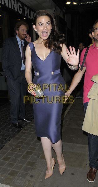 Hayley Atwell<br /> 'The Pride' Press Night at Trafalgar Studios, Whitehall, London, England.<br /> August 13th 2013<br /> full length purple peplum dress cleavage silver clutch bag hand arm palm waving mouth open funny<br /> CAP/CAN<br /> &copy;Can Nguyen/Capital Pictures