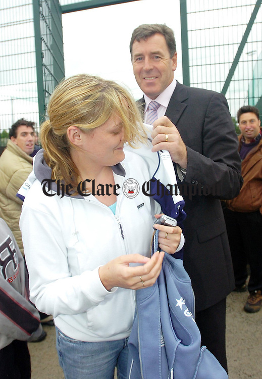 Former Irish International Goalkeeper Pakie Bonner signs a jersey for fan Lorraine Kearce during his visit to Cloughleigh All Weather pitch in Ennis.Pic Arthur Ellis.