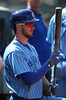 OAKLAND, CA - AUGUST 6:  Kris Bryant #17 of the Chicago Cubs stands in the dugout during the game against the Oakland Athletics at the Oakland Coliseum on Saturday, August 6, 2016 in Oakland, California. Photo by Brad Mangin
