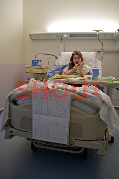 Young girl recovering in her hospital bed eating her evening meal. This image may only be used to portray the subject in a positive manner..©shoutpictures.com..john@shoutpictures.com