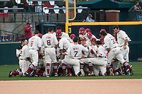 Alabama Crimson Tide kneel for a team prayer at Baum Stadium during the NCAA baseball game against the against the Arkansas Razorbacks on March 21, 2014 in Fayetteville, Arkansas.  The Alabama Crimson Tide defeated the Arkansas Razorbacks 17-9.  (William Purnell/Four Seam Images)