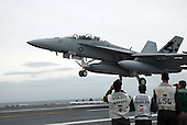 Atlantic Ocean - May 19, 2009 - An F/A-18C Hornet assigned to Air Test and Evaluation Squadron (VX) 23 makes the first arrested landing Tuesday, May 19, 2009 aboard the aircraft carrier USS George H.W. Bush (CVN 77). George H.W. Bush is the tenth and final Nimitz-class aircraft carrier and is underway off the coast of Virginia conducting flight deck certification. .Credit: Michael Tackitt - U.S. Navy via CNP