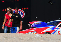 Apr. 2, 2011; Las Vegas, NV, USA: NHRA pro stock driver Shane Gray (right) with wife Amber Gray during qualifying for the Summitracing.com Nationals at The Strip in Las Vegas. Mandatory Credit: Mark J. Rebilas-