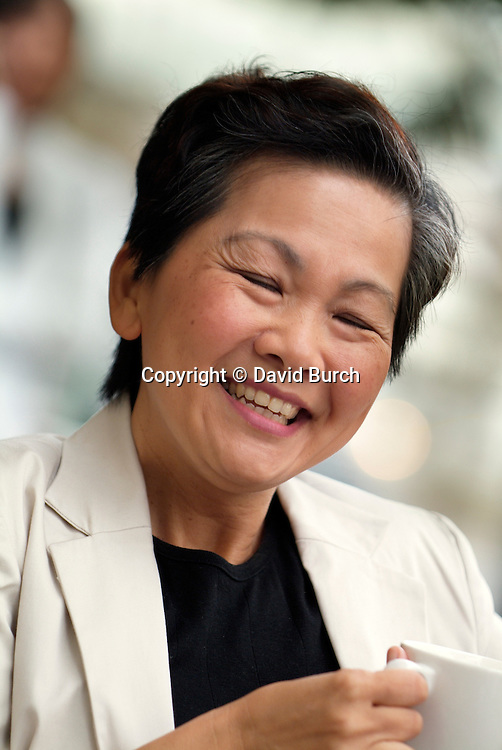 Smiling Asian woman, eyes closed