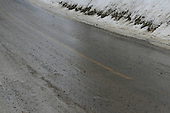 slippery road conditions, asphalt road becomes icy after freezing rain