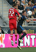CHESTER, PA - AUGUST 12, 2012:  Chandler Hoffman (12) of the Philadelphia Union is beaten to a header by  Austin Berry (22) of the Chicago Fire during an MLS match at PPL Park, in Chester, PA on August 12. Fire won 3-1.