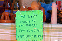 "Pictured: A sign which reads ""A Tirnavos penis a day, keeps the doctor away"" in Tirnavos, central Greece. Monday 11 March 2019<br /> Re: Bourani (or Burani) the infamous annual carnival which dates to 1898 which takes place on the day of (Clean Monday), the first days of Lent in Tirnavos, central Greece, in which men hold phallus shaped objects as scepters in their hands."