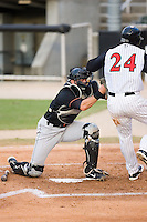 Delmarva Shorebirds catcher Brendan Monaghan (15) puts the tag on Christian Marrero (24) of the Kannapolis Intimidators at Fieldcrest Cannon Stadium in Kannapolis, NC, Wednesday, May 14, 2008.