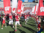 Wisconsin Badgers teammates run onto the field during an NCAA Big Ten Conference football game against the Maryland Terrapins Saturday, October 21, 2017, in Madison, Wis. The Badgers won 38-13. (Photo by David Stluka)