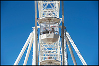 BNPS.co.uk (01202 558833)<br /> Pic: PhilYeomans/BNPS<br /> <br /> The new Ferris Wheel on Bmth beach gives spectacular views.<br /> <br /> Sizzling Sunday - Holidaymakers make the most of the first hot weekend of the year on Bmth beach today.