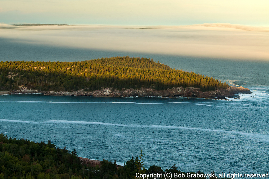 Fog moving in towards Great Head in Acadia National Park in Maine