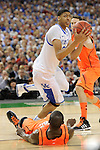 31 MAR 2012: Forward Anthony Davis (23) from the University of Kentucky is called for a charging against Gorgui Dieng (10) from the University of Louisville during the Semifinal Game of the 2012 NCAA Men's Division I Basketball Championship Final Four held at the Mercedes-Benz Superdome hosted by Tulane University in New Orleans, LA. Ryan McKeee/ NCAA Photos.