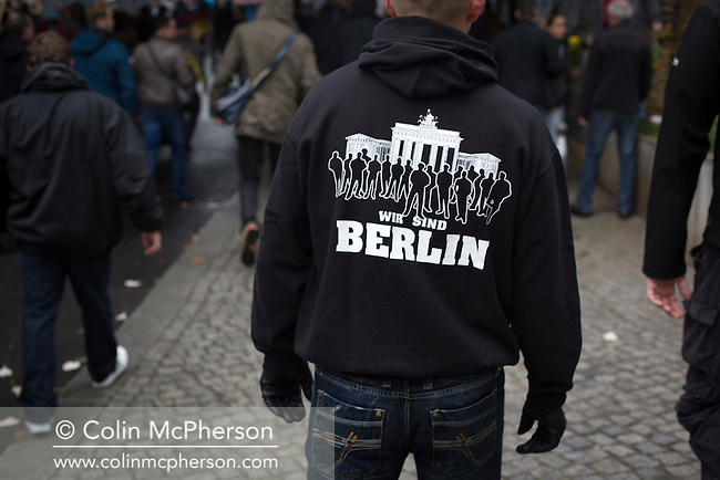 "A man with a ""We are Berlin"" motif on his shirt marching through the streets of Berlin during a demonstration by the Alternative für Deutschland (AfD) political party. Around 5000 supporters of the AfD took part in the march and rally calling on German Chancellor Angela Merkel to halt the influx of refugees into the country. Around one million refugees from the Middle East and north Africa arrived in Germany during 2015, 50,000 of whom came to Berlin."