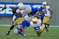 Lo Wood (23) tackles Air Force Falcons wide receiver Sam Gagliano (4) in the third quarter.