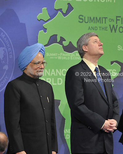 Washington, D.C. - November 15, 2008 -- Stephen Harper, Prime Minister of Canada, right, looks towards the ceiling as he and Dr. Manmohan Singh, Prime Minister of India, left, pose for a class photo with other world leaders at the Summit on Financial Markets and the World Economy at the National Building Museum in Washington, D.C. on Saturday, November 15, 2008. .Credit: Ron Sachs / Pool via CNP