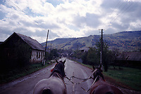 ROMANIA / Maramures / Strimtura / October 2003..A view down the main road of the Iza valley from a horse cart returning from the Friday morning market. The Iza valley, until recently, preserved villages in a state of almost medieval isolation...© Davin Ellicson / Anzenberger