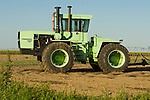 Mid 1980s Steger Cougar IV KS-280 tractor in the field with disc harrow, Sherman Co., Kansas.