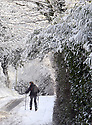 Eoin O'Coisneachain skies his way home from the shops following a heavy snow fall near Lisburn, County Antrim, Friday, December 8th, 2017. Photo/Paul McErlane