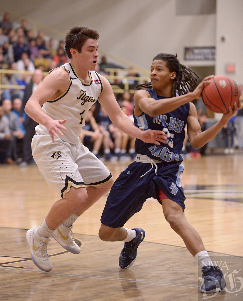 NWA Democrat-Gazette/BEN GOFF @NWABENGOFF<br /> Aaron Estrada of Bentonville guards Jayden Hampton of Springdale Har-Ber on Friday Jan. 15, 2016 during the game in Bentonville's Tiger Arena.