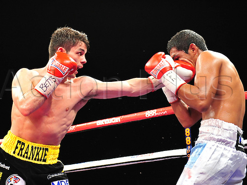 21.05.2014.  Leeds, England.  Stephen Smith targets Mauricio Javier Munoz with a jab during their fight for the vacant WBC Silver Super Featherweight Title The First Direct Arena.