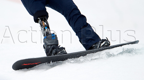 14.03.2014. Sochi, Russia.  An athlete with a lower limb prosthesis in action during the Men's Para-Snowboard in Rosa Khutor Alpine Center at the Sochi 2014 Paralympic Winter Games, Krasnaya Polyana, Russia, 14 March 2014.