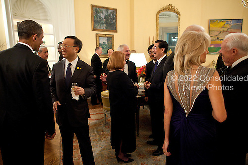 United States President Barack Obama and President Hu Jintao of China talk with guests during a reception in the Yellow Oval Room in the Residence of the White House before the start of the State Dinner, Wednesday, January 19, 2011. .Mandatory Credit: Pete Souza - White House via CNP