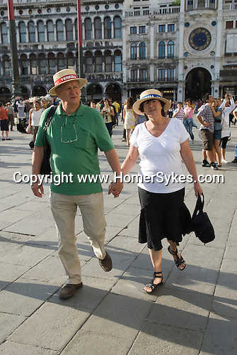 Venice Italy 2009. Couple of tourists in St Marks Square. Piazza Sab Marco.