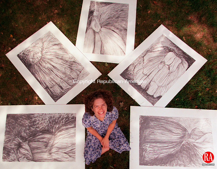 """WOODBURY, CT 09/02/98--0902CA01.tif  Carey McDougall an artist from Middlebury dispays a series of five graphite drawings on rag. Carey calls the work """"Life Stalks"""". --CRAIG AMBROSIO staff photo for REPORTERS NAME Amy Welch/ STANDALONE PHOTO  (Filed in Scans/Scan-In)"""