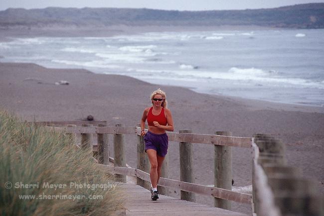 Woman running at Bodega Dunes State Park
