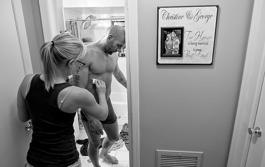 George Sullivan's fiancée Christine Rusher uses a $25 Vanilla Visa gift card to scrape sweat from George's body after he finished a special epsom salt bath in an attempt to cut weight for his bout in less than two days.