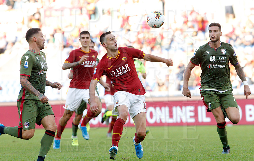 Roma's Nikola Kalinic, center, is challenged by Cagliari's Luca Ceppitelli, right, during the Serie A soccer match between Roma and Cagliari at Rome's Olympic Stadium, October 6, 2019. UPDATE IMAGES PRESS/ Riccardo De Luca