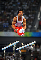 Aug. 9, 2008; Beijing, CHINA; Raj Bhavsar (USA) performs on the parallel bars during mens gymnastics qualification during the Olympics at the National Indoor Stadium. Mandatory Credit: Mark J. Rebilas-