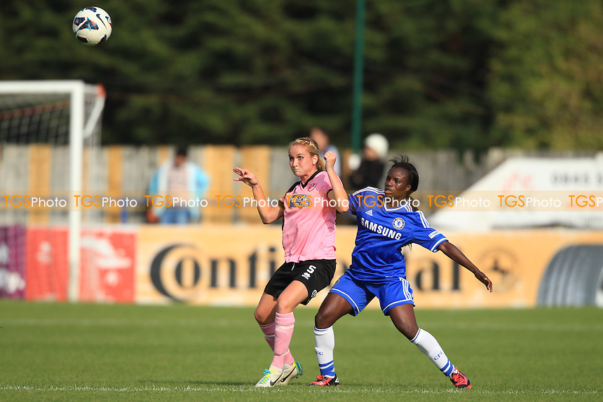 Sophie Bradley of Lincoln comes under pressure from Enilo Aluko of Chelsea - Chelsea Ladies vs Lincoln Ladies - FA Womens Super League Football at Staines Town FC - 29/09/13 - MANDATORY CREDIT: Simon Roe/TGSPHOTO - Self billing applies where appropriate - 0845 094 6026 - contact@tgsphoto.co.uk - NO UNPAID USE