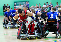 15 AUG 2011 - LEEDS, GBR - Mike Whitehead of Canada tries to steer through challenges from Great Britain's Aaron Phipps (number 13) and Jonny Coggan (number 2) during the wheelchair rugby international between the two teams (PHOTO (C) NIGEL FARROW)