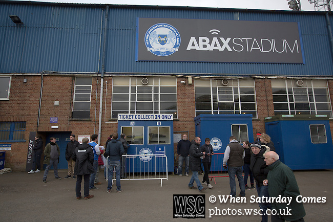 Peterborough United 1 Chesterfield 0, 21/03/2015. Abax Stadium, League One. Supporters queueing for tickets outside the old main stand at the Abax Stadium, before Peterborough United play Chesterfield in a SkyBet League One fixture. The home team won the match by one goal to nil, watched by a crowd of 6,612. The result allowed Peterborough to leapfrog their opponents into the League One play-off positions with eight games remaining of the season. Photo by Colin McPherson.