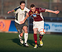 Stranraer's Sean Winter and Stenny's Kevin McKinlay challenge for the ball.