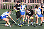 Santa Barbara, CA 02/18/12 - Maegan Cruse (UCSB #16), Christina Scaduto (Washington #8) and Katie Mitchell (UCSB #21) in action during the UCSB-Washington matchup at the 2012 Santa Barbara Shootout.  UCSB defeated Washington