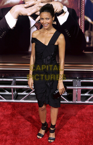 "THANDIE NEWTON.""W."" New York Premiere of Oliver Stone's movie held at the Ziegfeld Theatre, New York, NY, USA..October 14th, 2008.full length black dress off the shoulder ruffled ruffles clutch bag straps sandals shoes .CAP/ADM/PZ.©Paul Zimmerman/AdMedia/Capital Pictures."