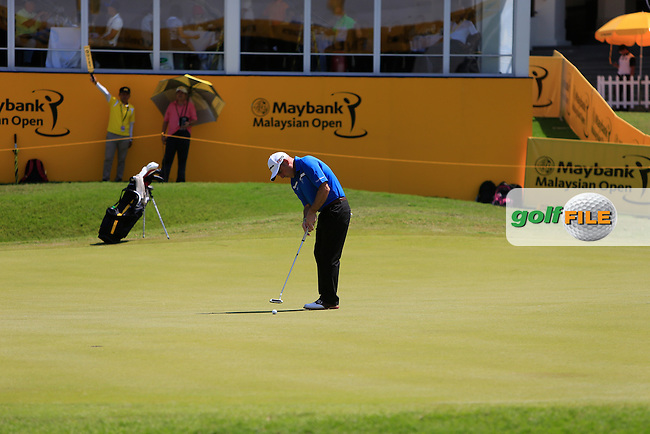 Paul McGinley (IRL) on the 18th green during Round 4 of the Maybank Malaysian Open at the Kuala Lumpur Golf &amp; Country Club on Sunday 8th February 2015.<br />